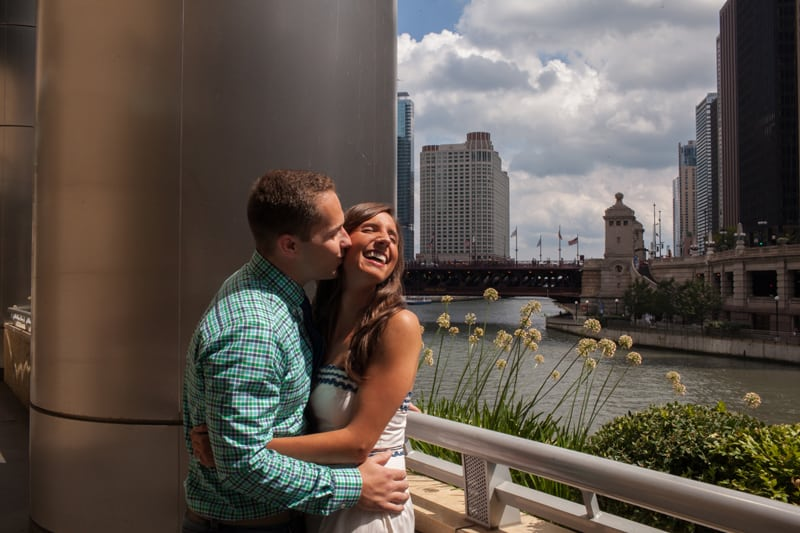 man kissing woman at engagement session in chicago