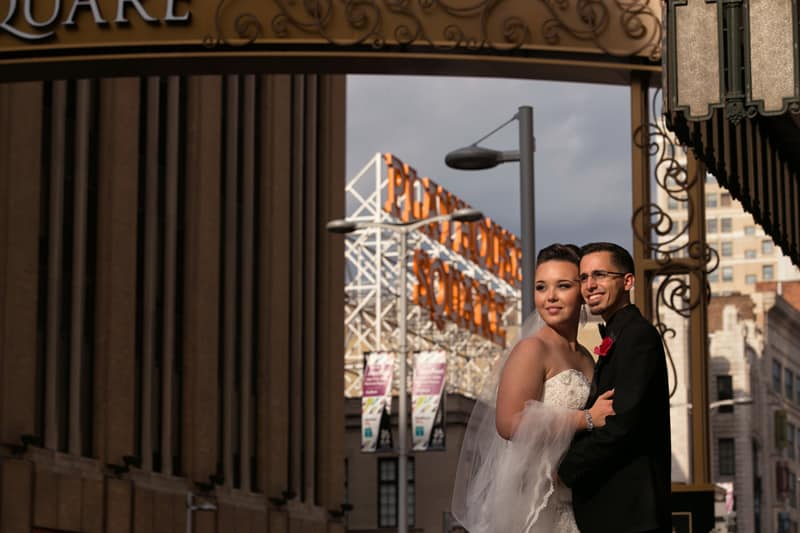 bride and groom posing at playhouse square