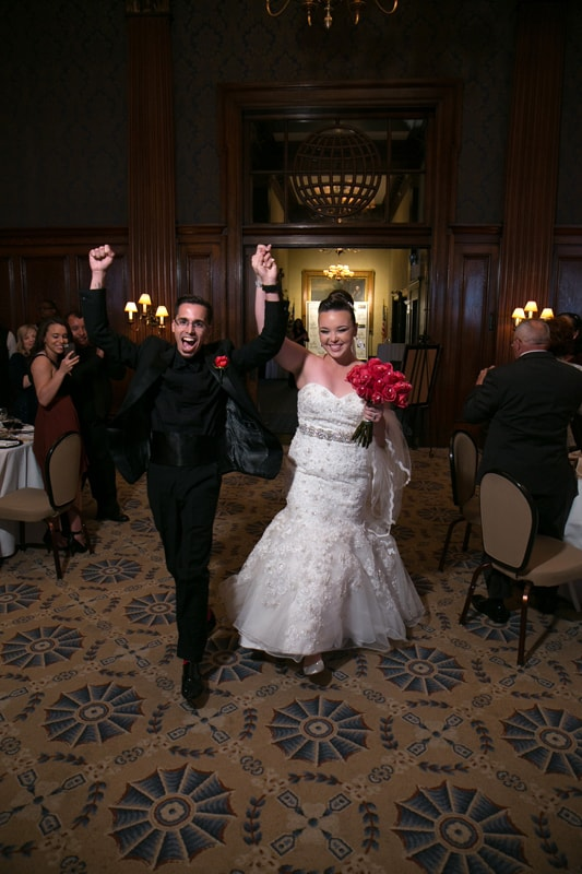 bride and groom enter their wedding reception at union club