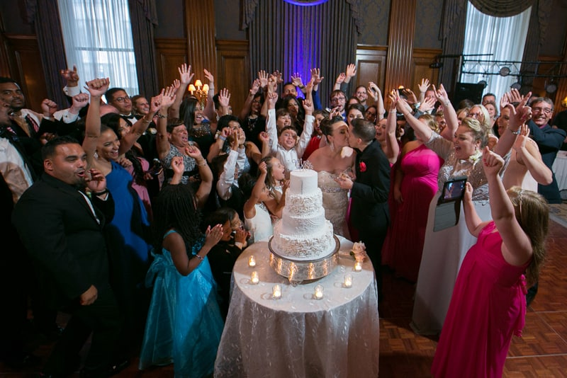 wedding guest cheer around wedding cake