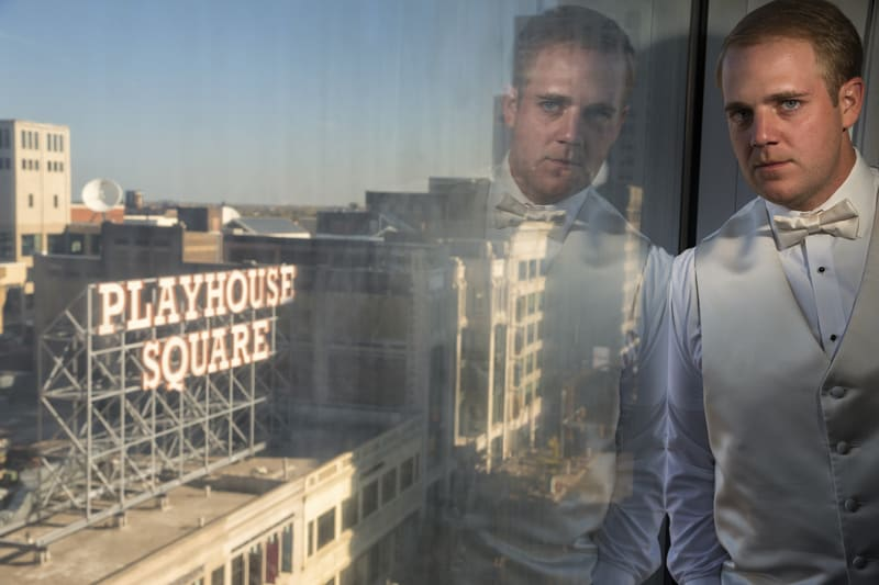 groom wedding picture with playhouse square