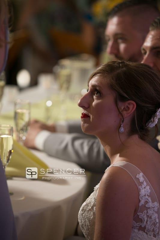 bride watching maid of honor speech at sandusky wedding reception