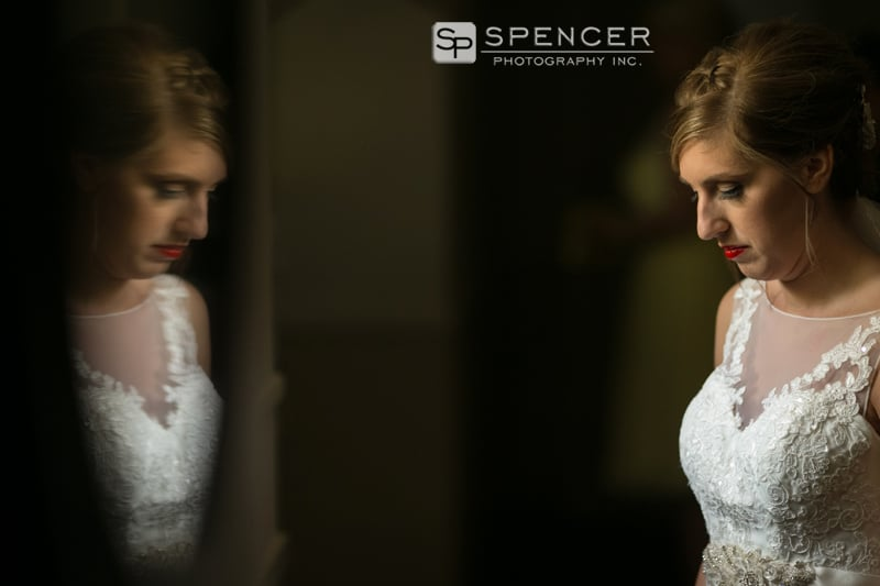 bride in reflection with wedding dress