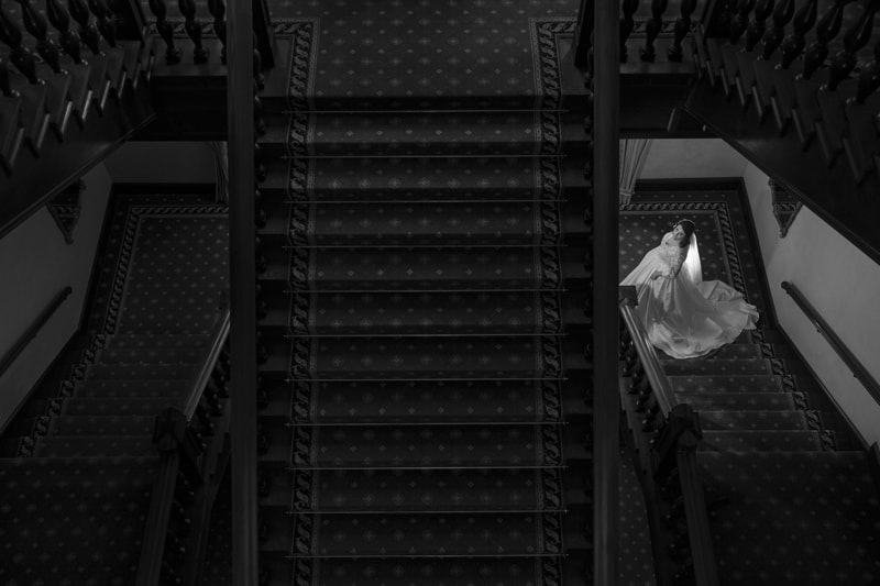bride on stairs of union club of cleveland wedding