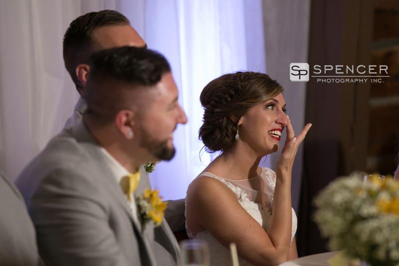 bride reacting to fathers wedding reception speecch