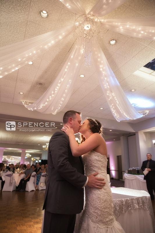 bride kissing groom at st. helenic