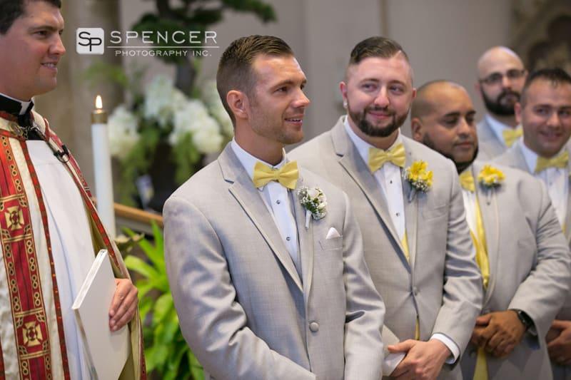 groom watching bride walk down aisle at st marys