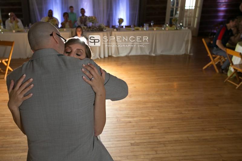 bride hugs dad at wedding reception in sandusky