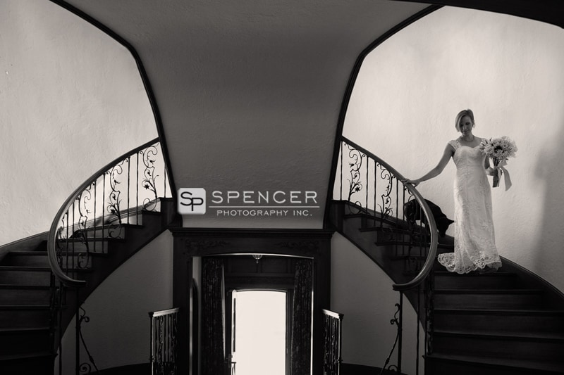 bride walking down staircase to meet groom on wedding day