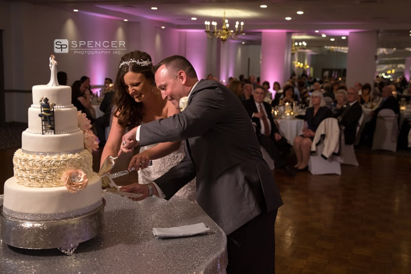 cake cutting at wedding reception at st. helenic center