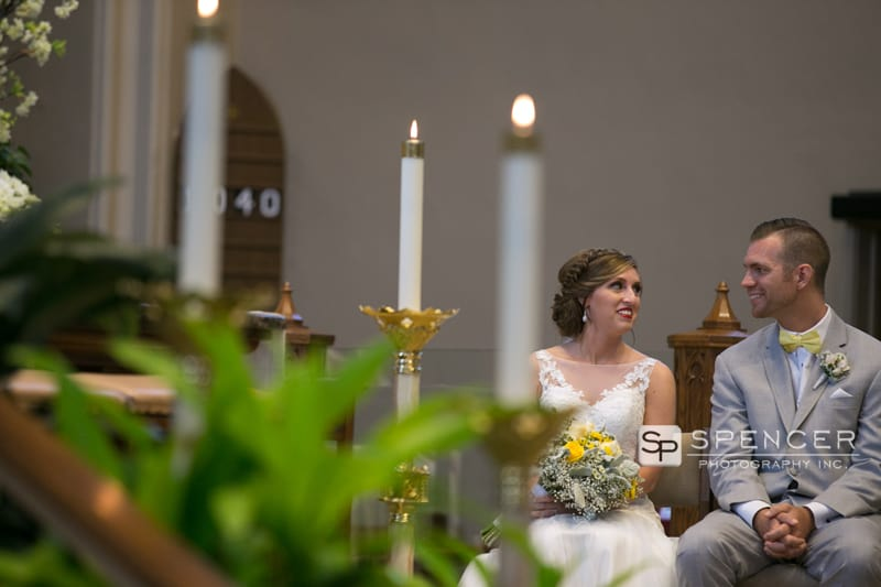 bride and broom smiling at wedding ceremony at st marys
