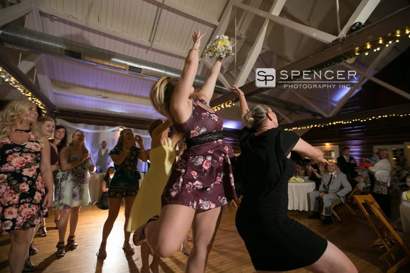 catching the bouquet at vermilion on the lake wedding reception