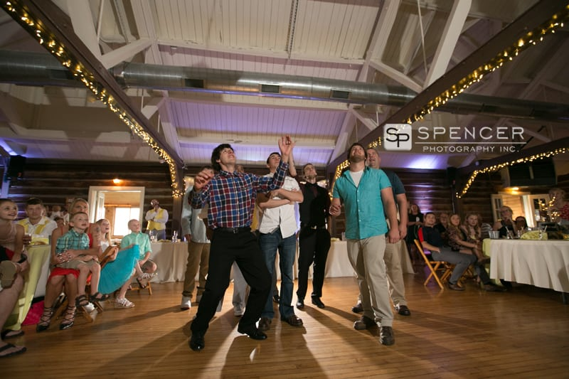garter toss at wedding reception at vermilion on the lake