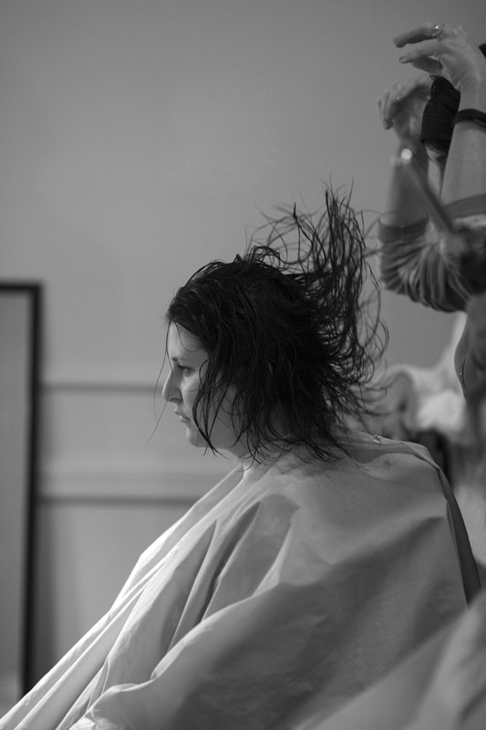 bride getting hair done at union club wedding day
