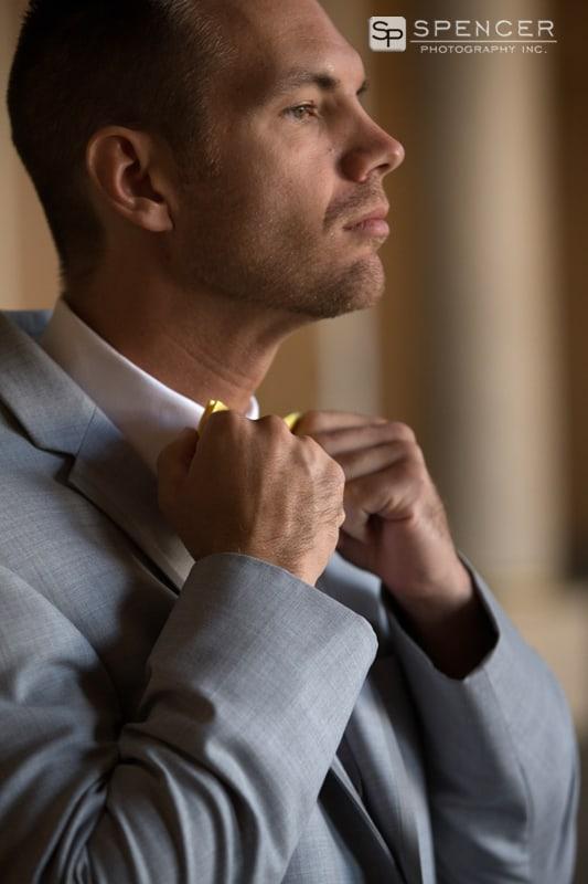 groom adjust tie