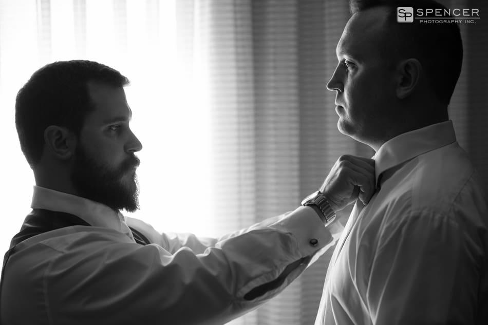 best man helping groom on wedding day in brecksville ohio