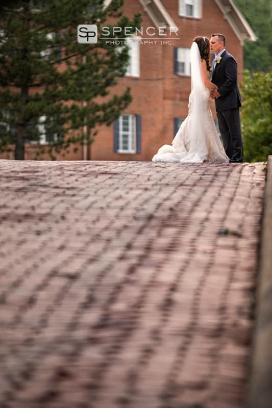 bridal couple kissing in street