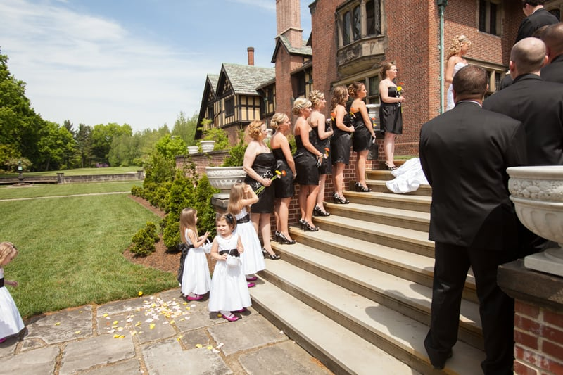 bridesmaids on stairs of stan hywet wedding
