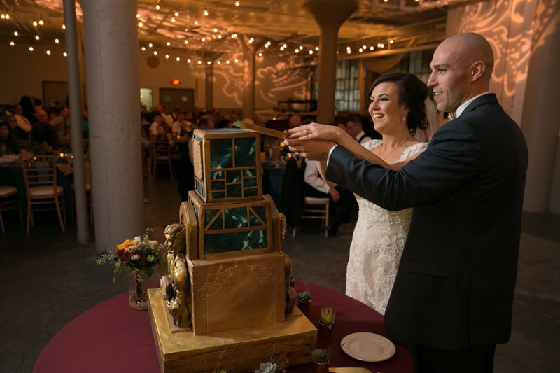 cutting cake at wedding reception at lake erie building