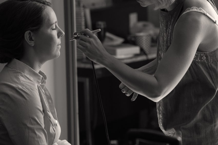 bride getting make up on wedding day at tudor arms