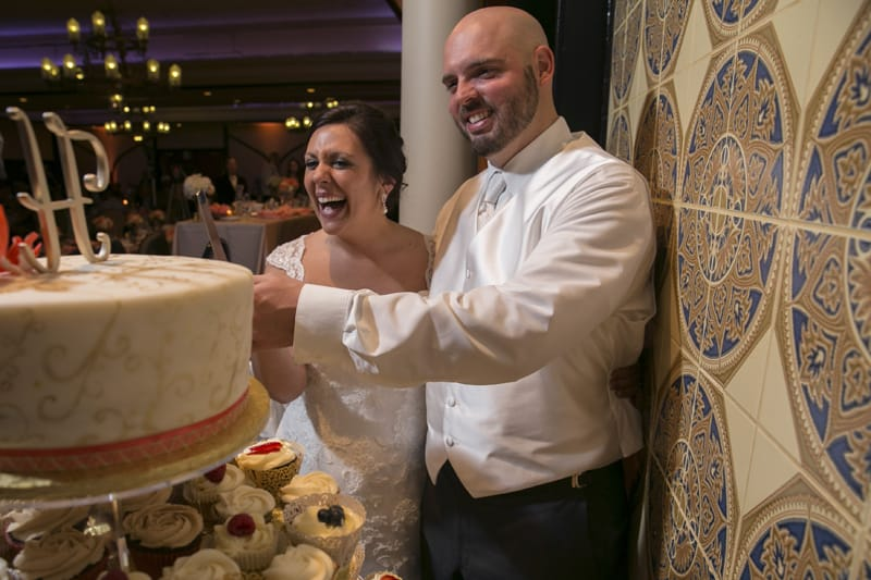 bride and groom cutting cake at tangier wedding reception