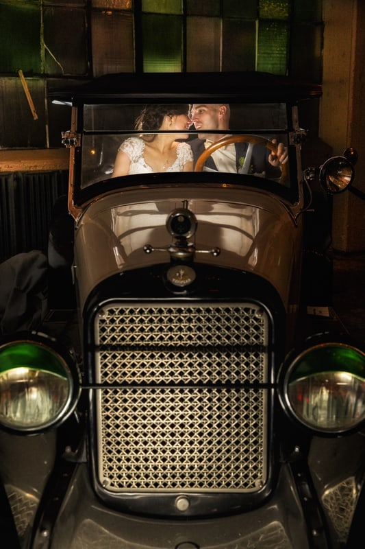 classic car at lake erie building with bride and groom
