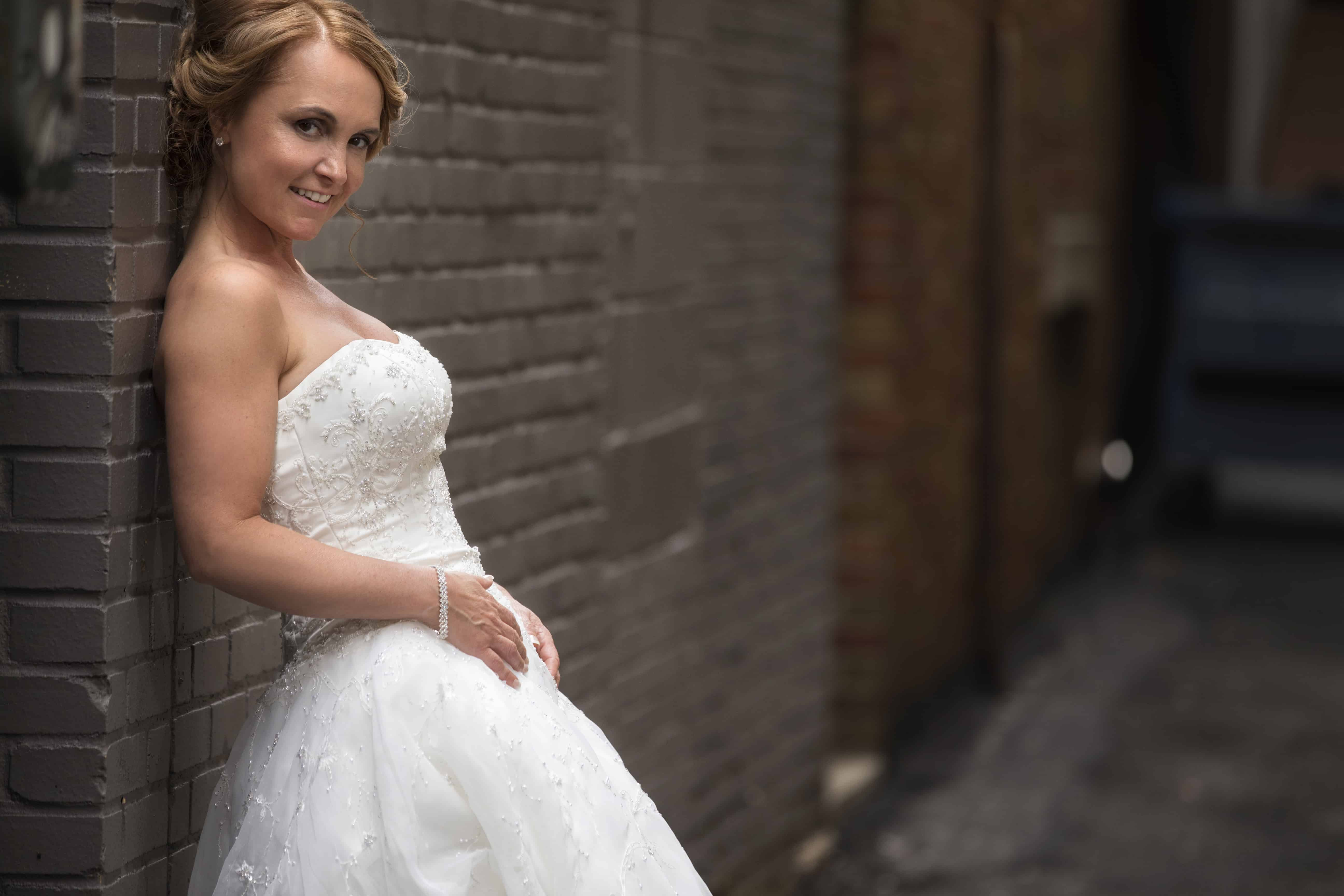 picture of bride in downtown akron alley