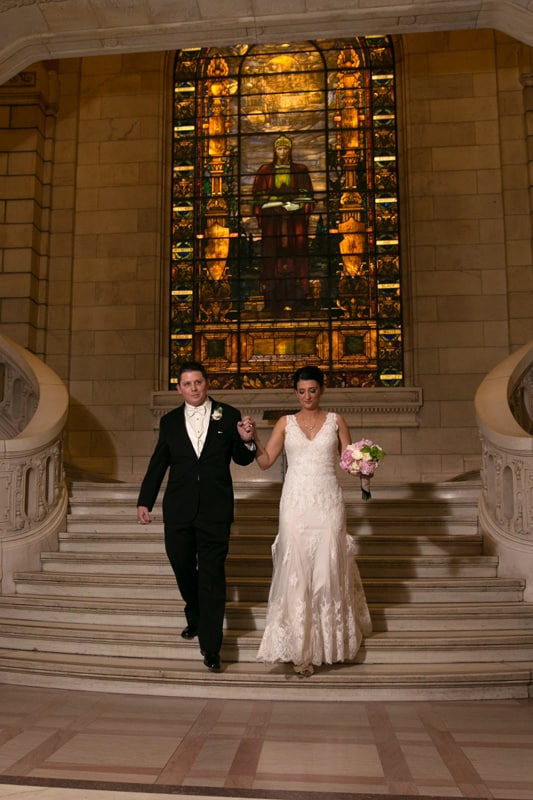 bride and groom enter their old courthouse reception