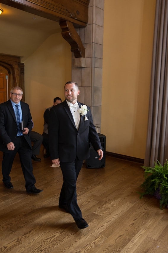 groom entering wedding ceremony