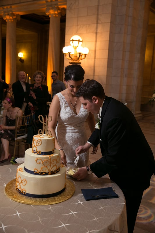 cutting their wedding cake at old courthouse
