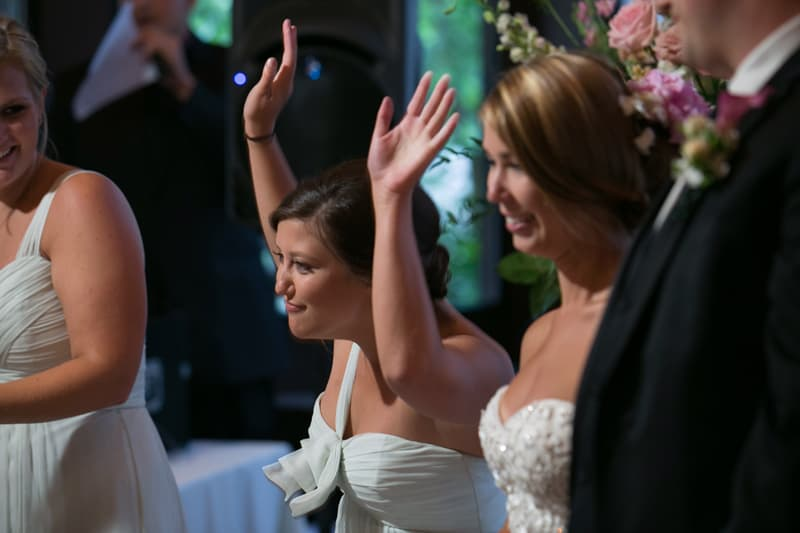 maid of honor cheering at reception head table
