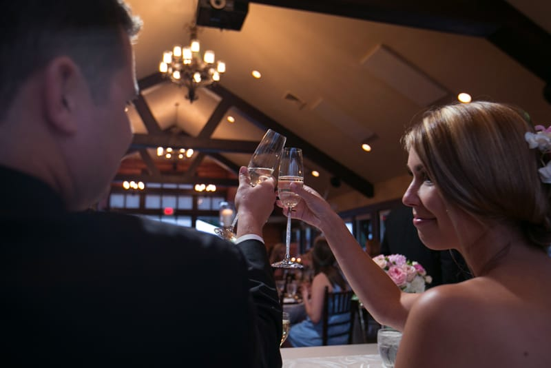 bride and groom toast at their wedding reception