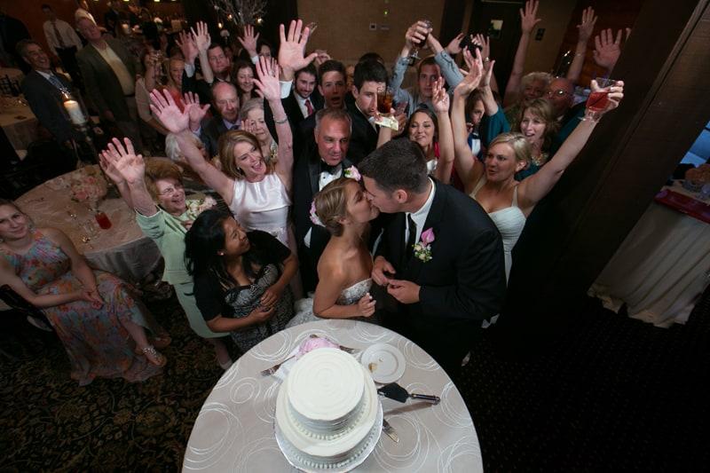 cutting their cake at firestone reception