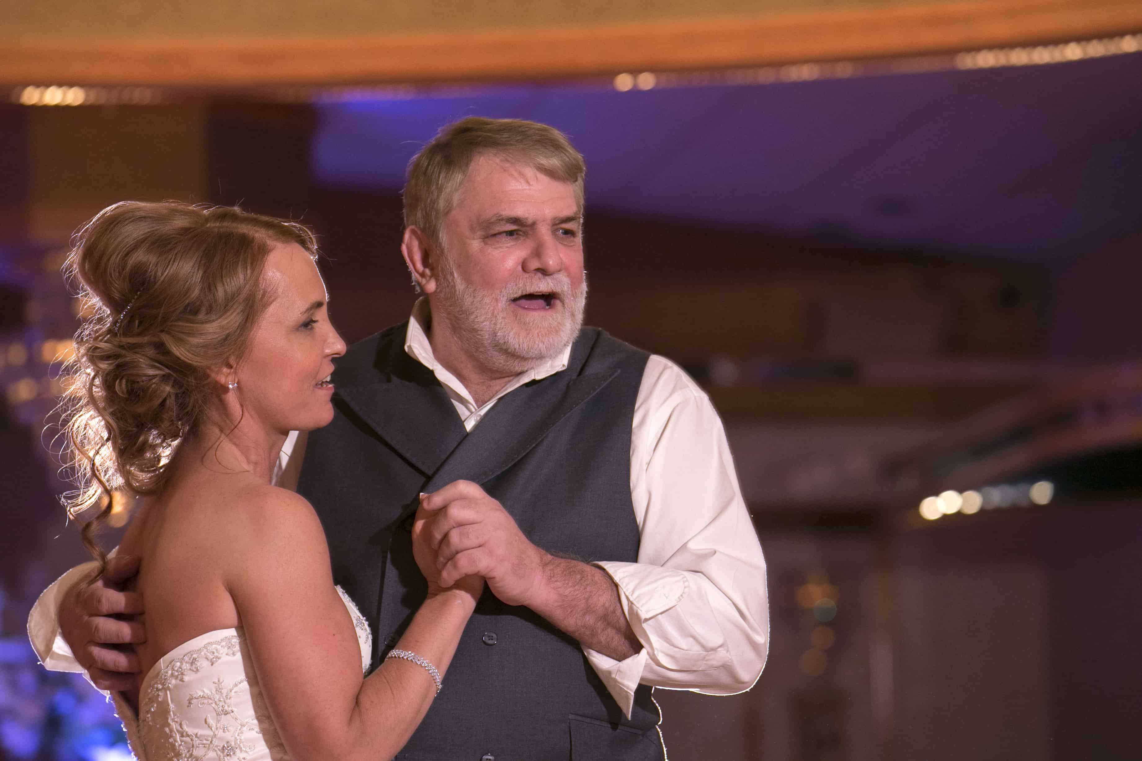 bride dancing with her dad at guys party center
