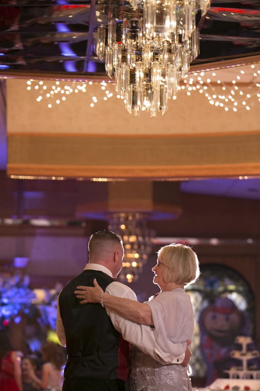 groom dancing with mom at guys party center