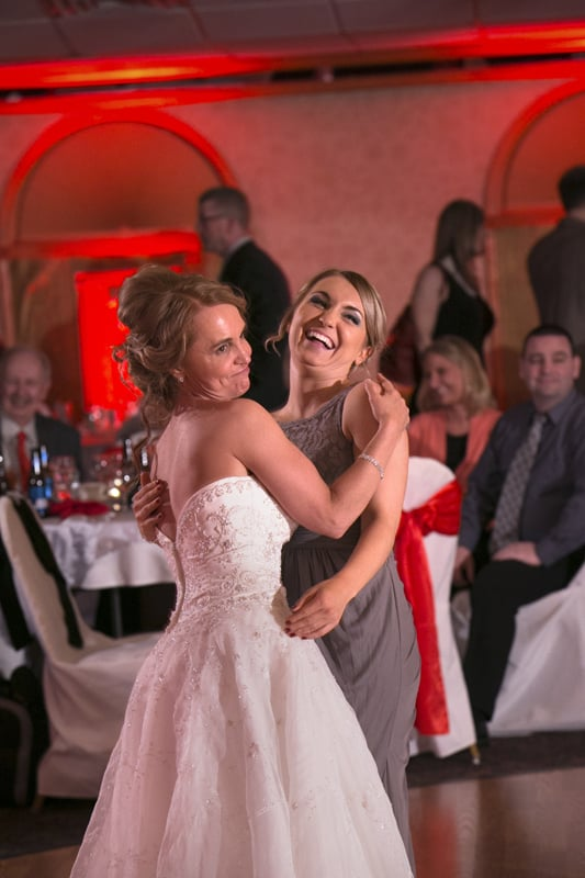 bride dancing with daughter at guys