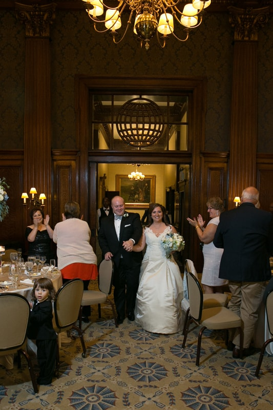 bride and groom entering wedding reception