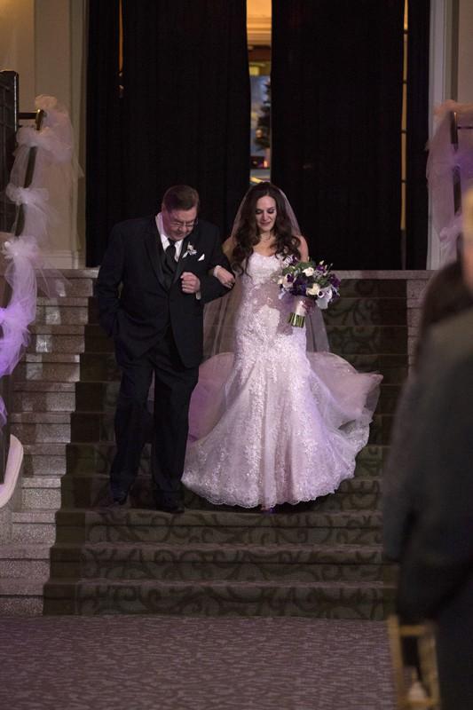 bride and dad entering wedding at park lane