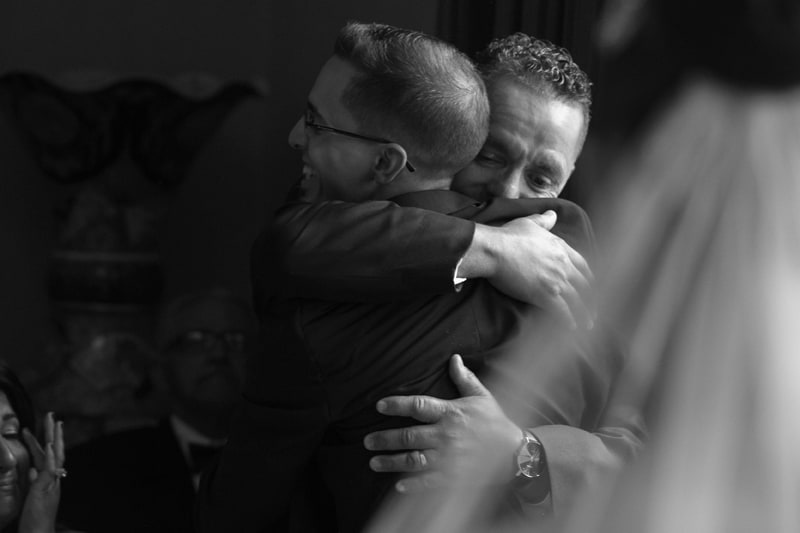 dad hugs groom