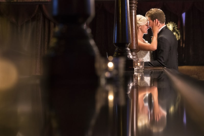 bride and groom kissing at foundation room bar
