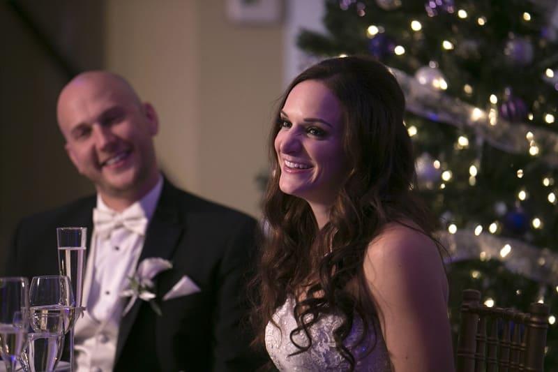 bride reacting to speech at ballroom at park lane wedding reception