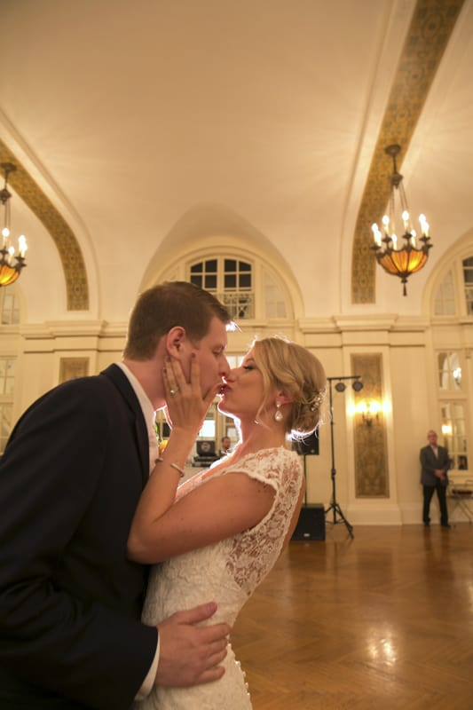 bride and groom kiss at their reception at greystone hall