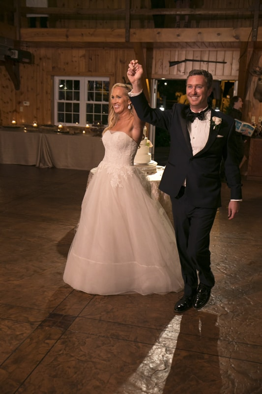 bride and groom enter their copley wedding reception