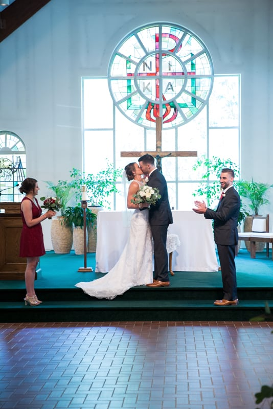 first kiss at wedding at divine word church