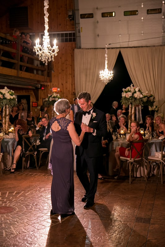 groom dances with mom at his copley wedding reception