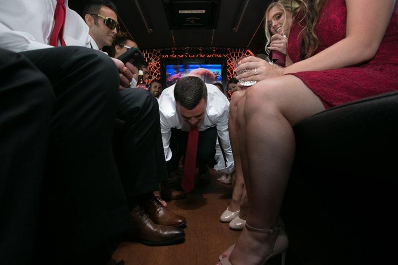 groom doing push ups on limo bus