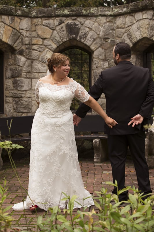 turning to see each other on wedding day at stan hywet