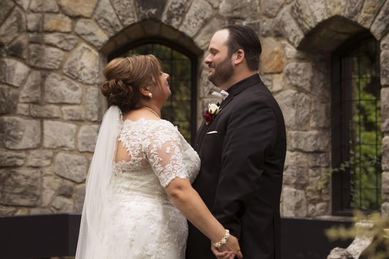 bride and groom in stan hywet english garden