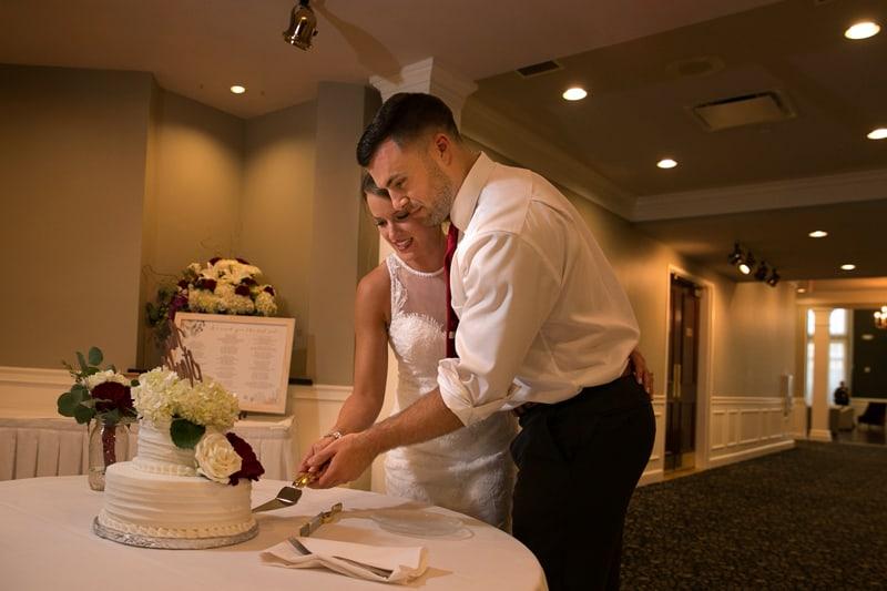bride an groom cutting wedding cake