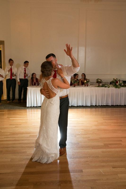 groom celebrating first wedding dance